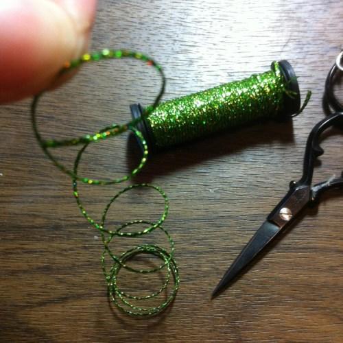 kreinik threads off spool with a curl