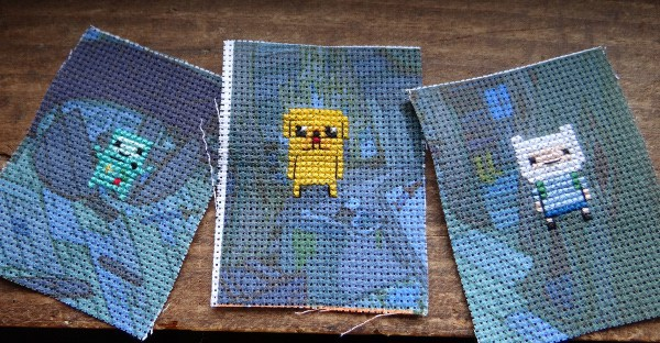 adventure time cross stitches with printed aida background by WonderStrange
