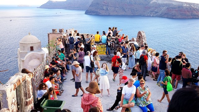 a lot of people waiting for sunset in Oia