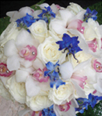 bouquet of white roses with blue delphinium blossoms