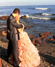 bride and groom embracing on the beach
