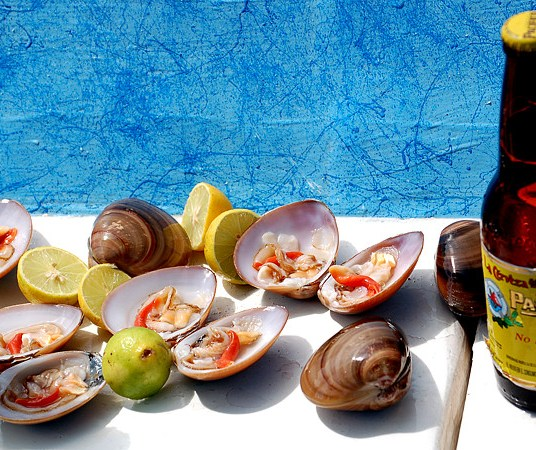 Fresh clams, lime, hot sauce and a cold beer brings pure bliss!