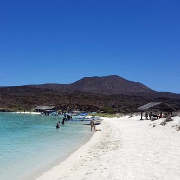 The beach on Coronado Island is a popular destination for boats from Loreto.