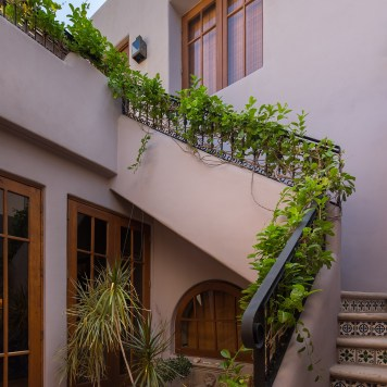 Inside is garden with stairs leading to one of the master suites and the patio.