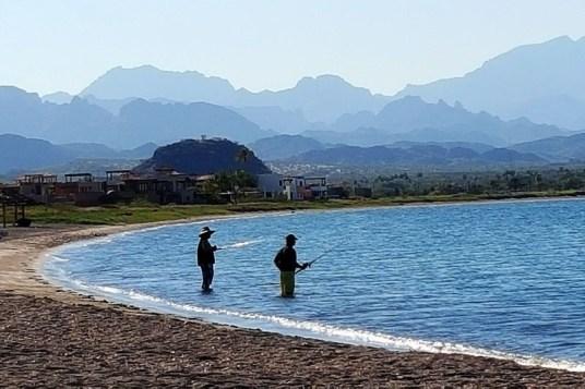Do a little fishing on the Loreto Bay beach as the Sierra de la Giganta mountains loom in the background.