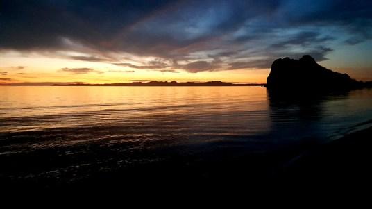 Sunrise behind Carmen Island and Nopolo Point.