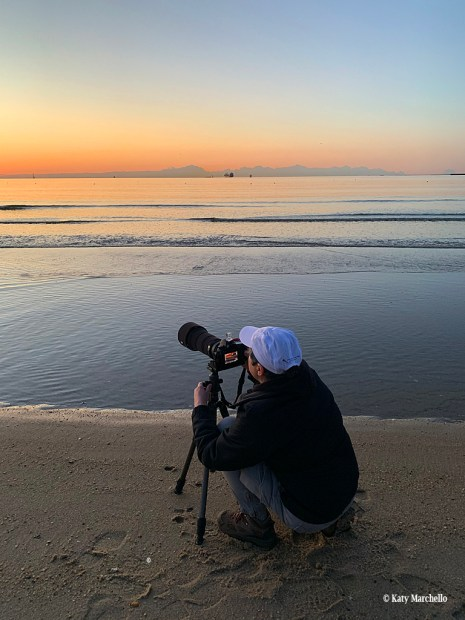 Lori A Cash photographing the sunrise at Fort Monroe National Monument in Hampton, Virginia.