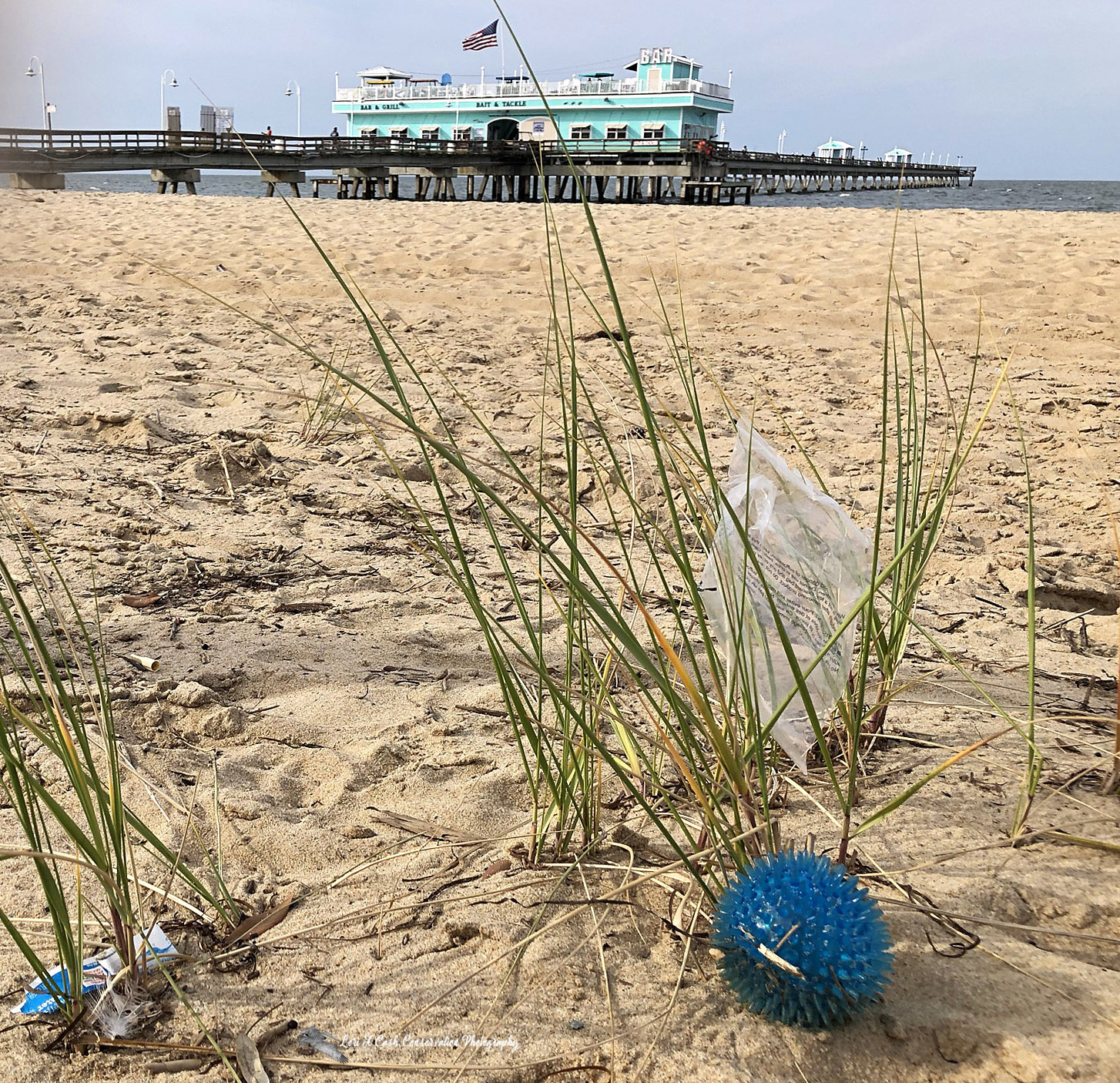 Litter on the beach at the Ocean View Fishing Pier in Norfolk, Virginia,