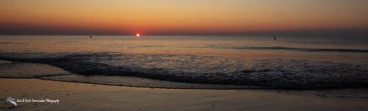 The sun rises up on the horizon on a summer morning at Buckroe Beach in Hampton, Virginia.