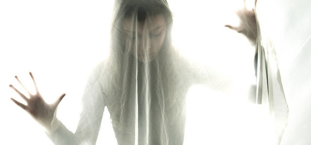 Woman with bipolar disorder appears to be under a veil because she feels veiled from her real self...and that no one can see who she really is.