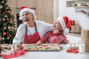 Christmas cheer and hanukkah happiness for grandma and grandchild together