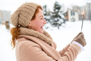 This happy lady in the snow knows that ketamine treatment erases suicidal thoughts.