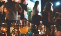 Alcoholic drinks at a holiday party are abundant and a strong temptation if you're trying to stay sober.