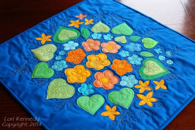 Floral raw edge appliqué with free motion quilting