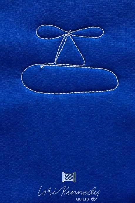 Machine quilt a plane motif