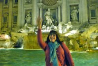 Throwing one last coin into Trevi Fountain
