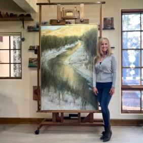 "Lori McNee in her Sun Valley studio with ""Last Light"" 60x40 oil on canvas"