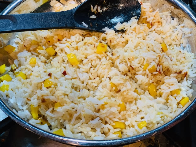 Spicy sesame coconut rice in a sauté pan.