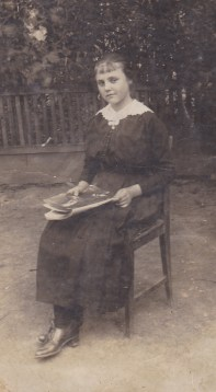A teenager in 1917 or so reading a magazine