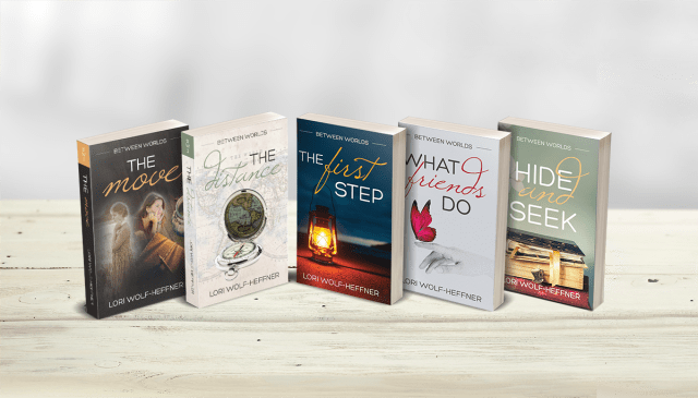 """Line-up of all five books from Lori Wolf-Heffner's series, """"Between Worlds."""""""