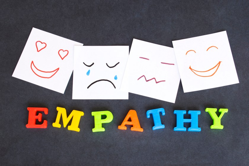 """The word """"empathy"""" spelled in colourful letters, with drawings of different facial expressions above"""