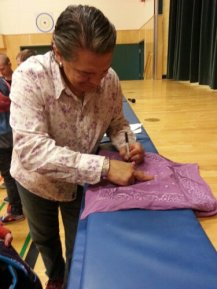 Lorne signing autographs on a school tour of the Peace Wapiti School District