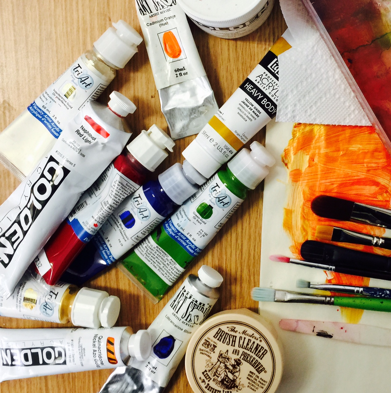 photo of acrylic paints, brushes and tools