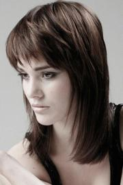 medium layered haircuts with bangs