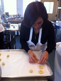 Maria making Brazilian thumbprint cookies