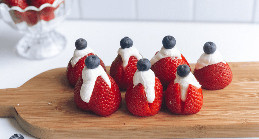 Healthy cheesecake stuffed strawberries topped with blueberries