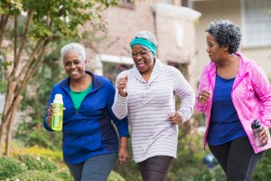 Three women exercising together