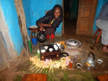 Tsige, my neighbor helping out by making coffee.