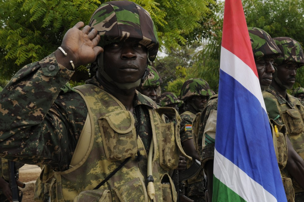 A_Gambian_soldier_salutes_during_Senegal's_national_anthem_during_the_opening_ceremonies_for_Western_Accord_2012_in_Thies,_Senegal,_June_9,_2012_120609-Z-KE462-133.jpg