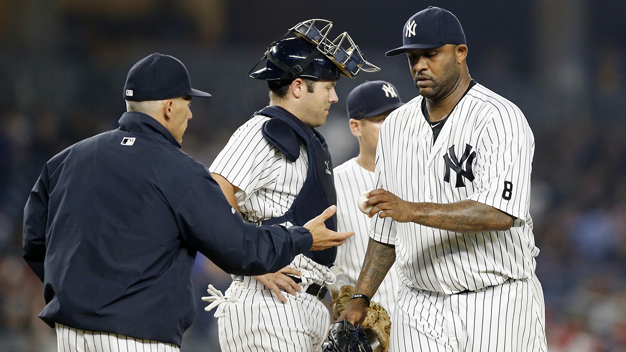 New York Yankees manager Joe Girardi, left, takes the ball from starting pitcher CC Sabathia during the eighth inning of a baseball game against the Texas Rangers in New York, Tuesday, June 28, 2016. New York Yankees catcher Austin Romine, center, is on the mound with Sabathia. (AP Photo/Kathy Willens)
