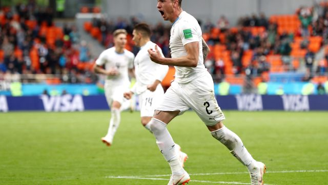YEKATERINBURG, RUSSIA - JUNE 15: Jose Gimenez of Uruguay celebrates after scoring his team's first goal during the 2018 FIFA World Cup Russia group A match between Egypt and Uruguay at Ekaterinburg Arena on June 15, 2018 in Yekaterinburg, Russia.