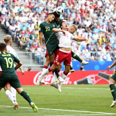 SAMARA, RUSSIA - JUNE 21: Thomas Delaney of Denmark challenge for the ball with Trent Sainsbury and Mile Jedinak of Australia during the 2018 FIFA World Cup Russia group C match between Denmark and Australia at Samara Arena on June 21, 2018 in Samara, Russia.