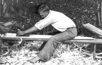 FIG. 131. Board for sowing tray being planed with jack plane. Avinurme, Ulvi village. Photograph by author, 1947. Photo library 1089:106.