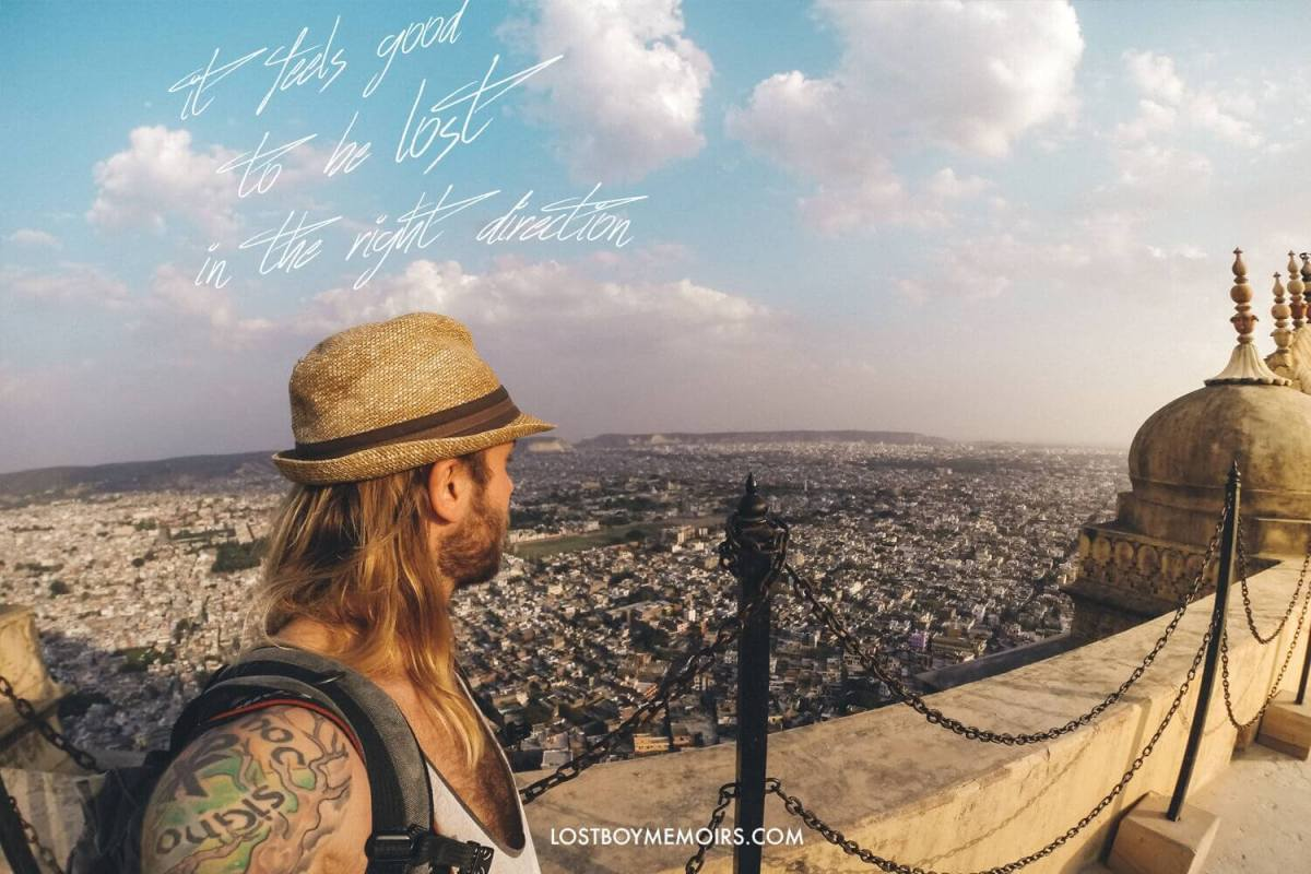 31 Inspirational Travel Quotes - It feels good to be lost in the right direction image of Ryan on Amber Fort in Rajasthan India.