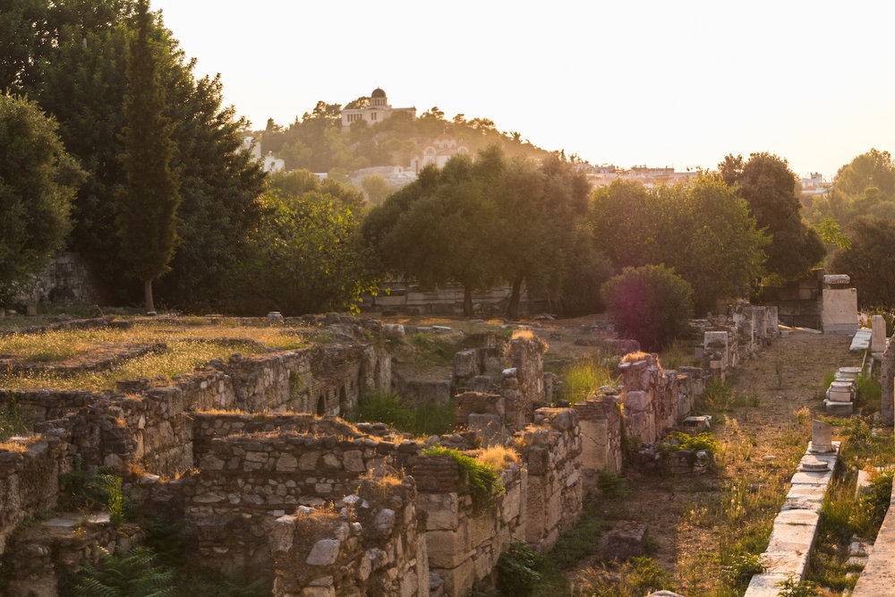 Photo of sunset over ancient ruins while lost in Athens Greece.
