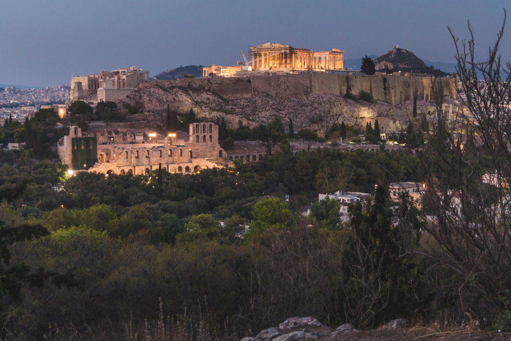 Long Exposure photo of Acropolis from Filopappos Hill while lost in Athens Greece.