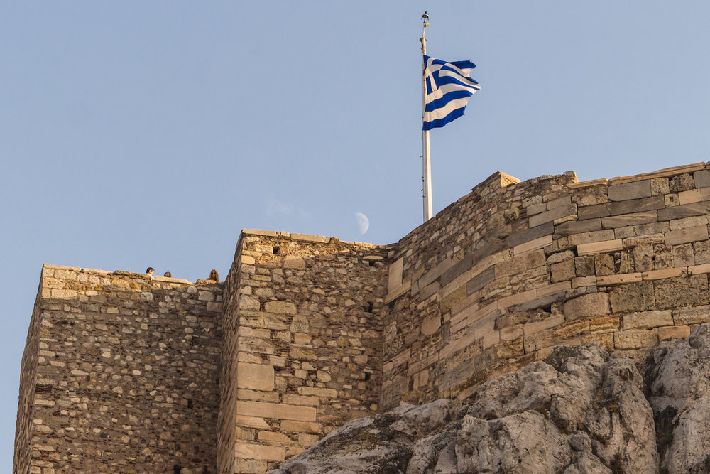 Photo of a Green flag and he half moon atop Acropolis.