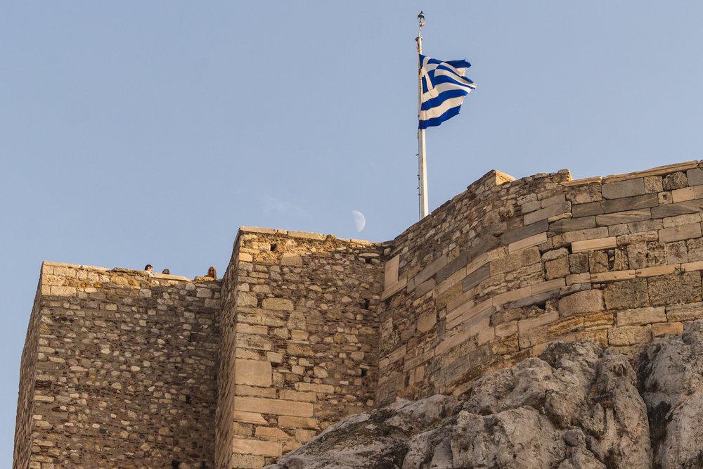 Photo of a Green flag and he half moon atop Acropolis.