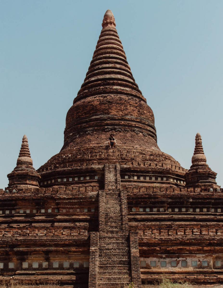 A Photo of Ryan Brown of Lost boy memoirs sitting atop a temple in Bagan, Myanmar