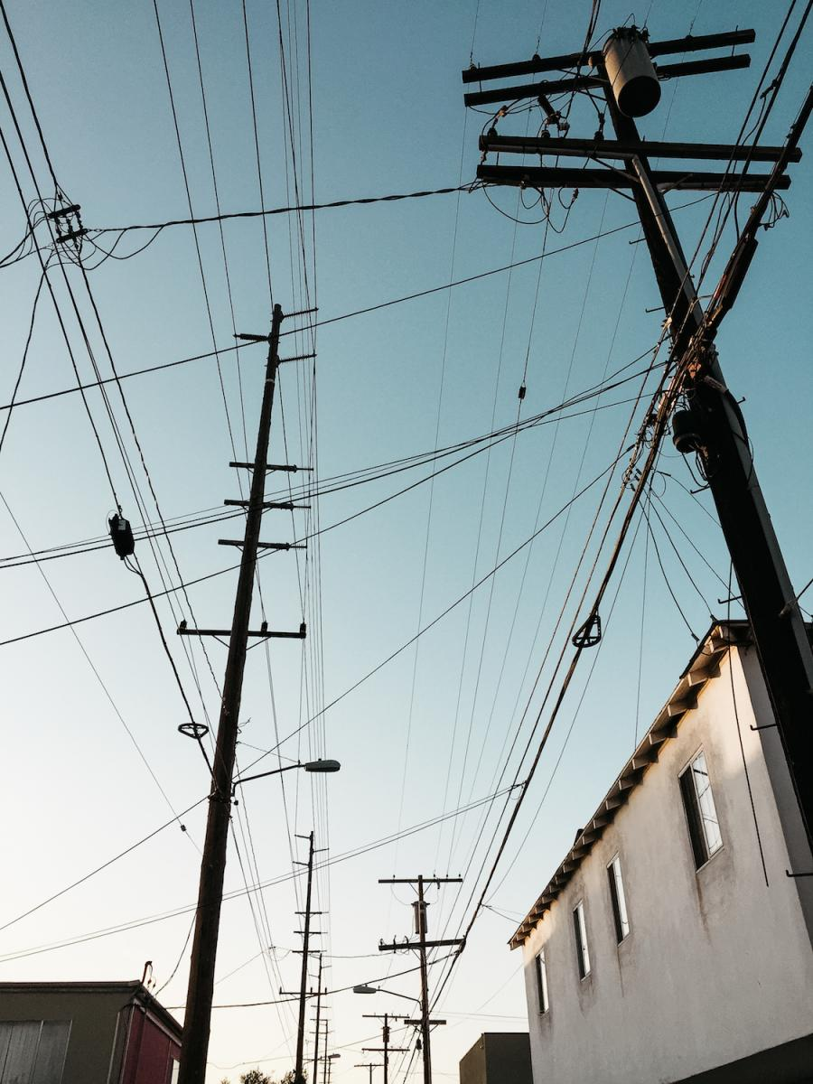 Lost in Los Angeles Photo Series. Powerlines criss-crossing against a blue sky at dusk.