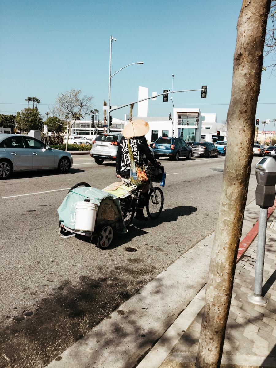 Lost in Los Angeles Photo Series. Photo of a man on a bicycle filled with trash in Los Angeles.