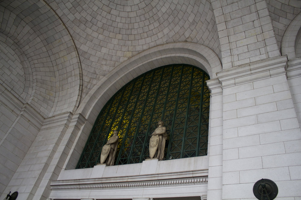 Low Angle Statues Above the Entrance.