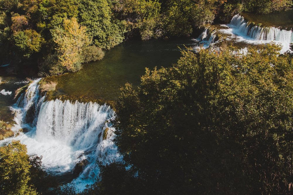 Dual Waterfalls in Krka Nationa Park Croatia. Photo taken with Canon 650D Rebel T4i, edited in Lightroom. Get the free Krka lightroom preset with cool highlights, warm shadows, and a gentle fade.