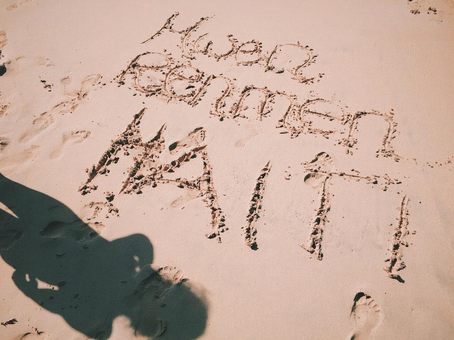 "Mwen Renmen Ayiti, or ""I Love Haiti"" written in the sand on Ile A Vache beach in Haiti."