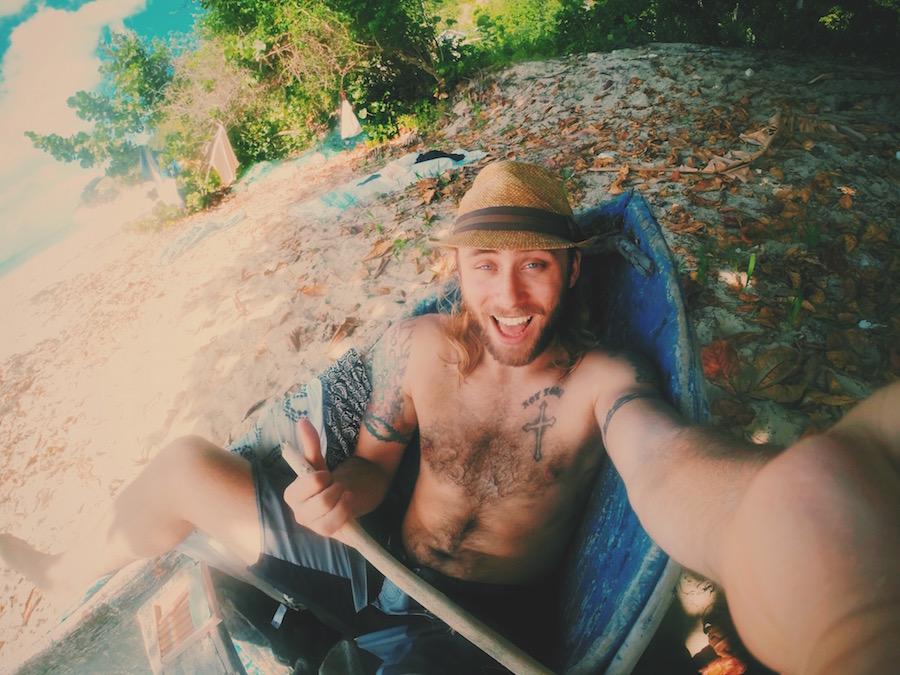 Beach selfie in a wooden canoe on Ile A Vache island in Haiti.
