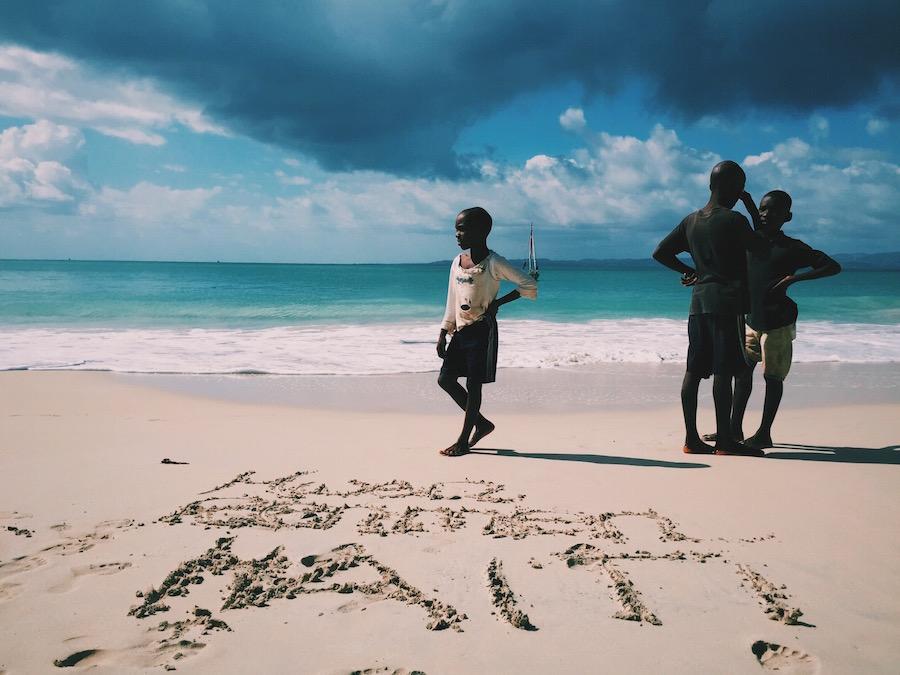 Haitian children standing on the beach in Ile A Vache, Haiti.